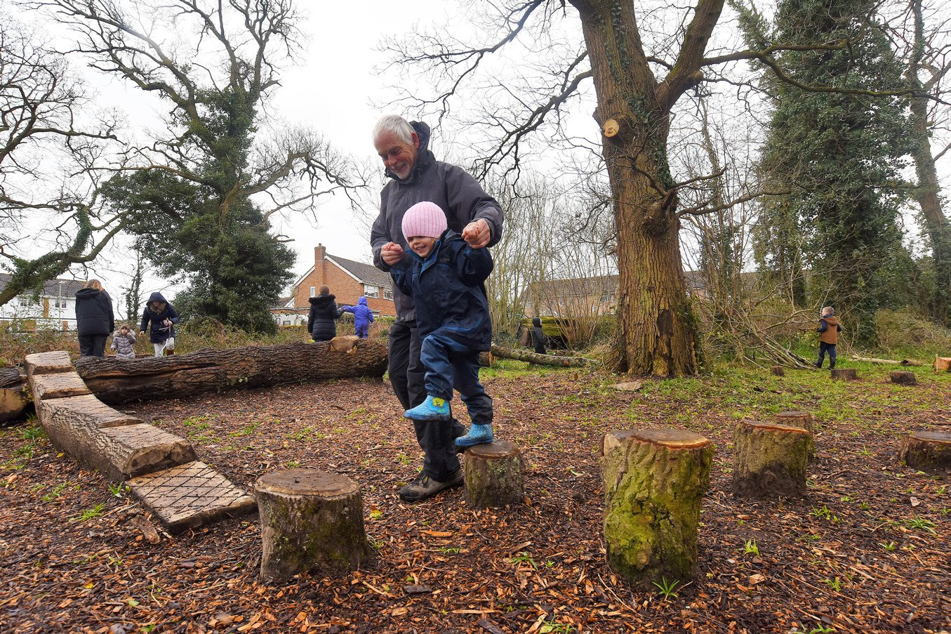 Children playing balancing games at the Holbury Manor wild play site opening April 2018