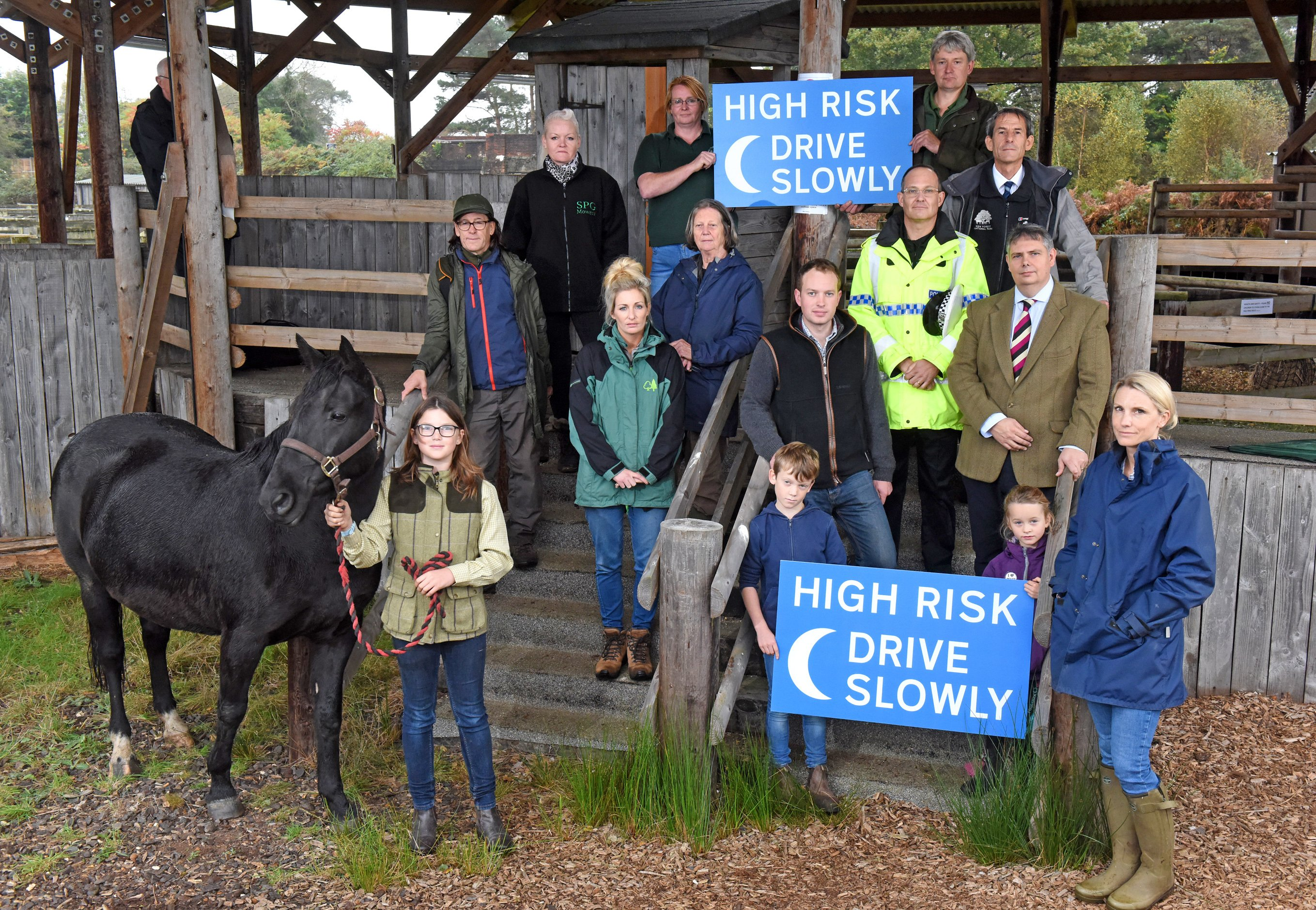New Forest commoners join representatives of local organisations at Beaulieu Road Sale Yard to appeal to local drivers to slow down as the clocks