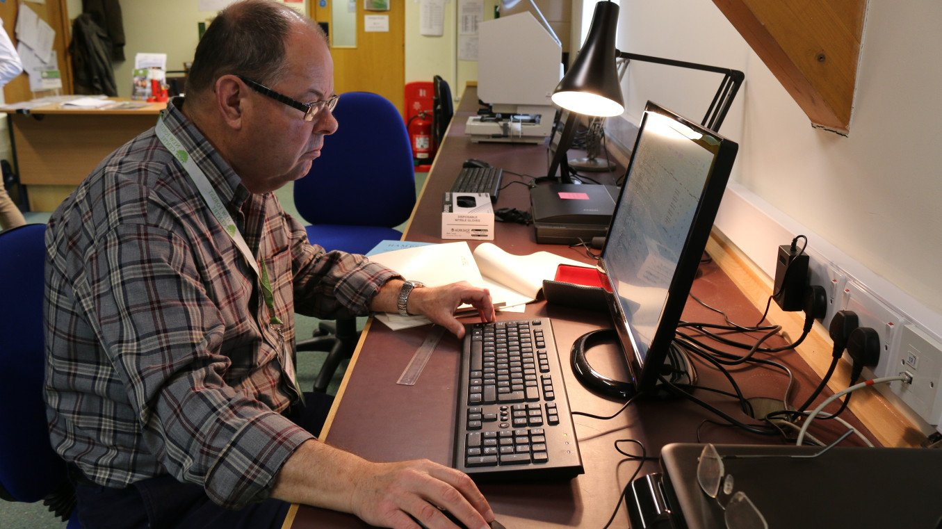 One of the volunteers at the Centre helping digitise the library's resources