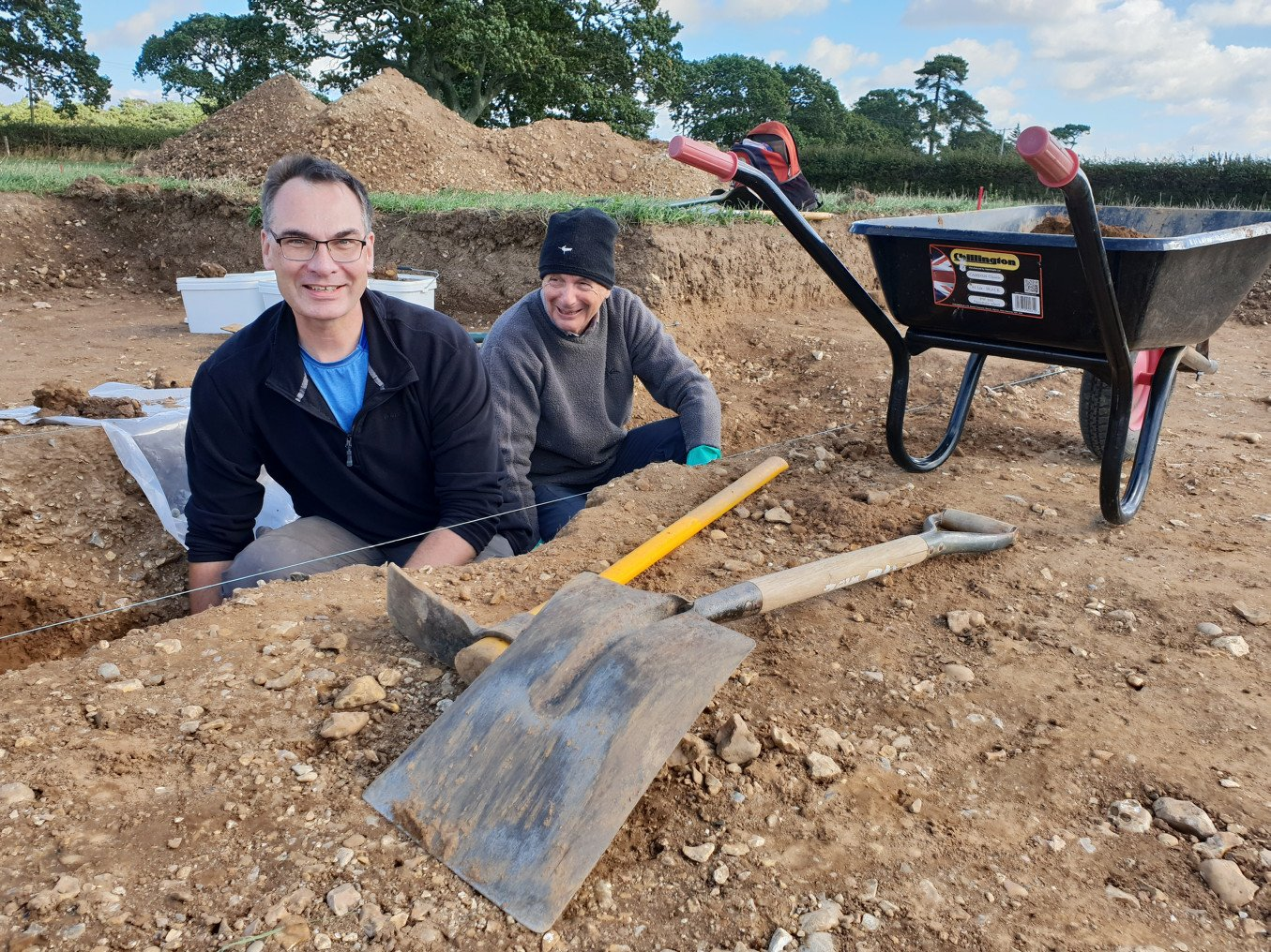 Volunteers Will Ward (left) and Owen Morgan helping with the excavation