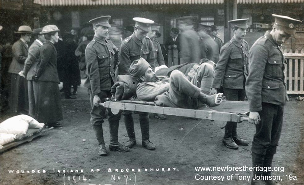 Wounded Indian soldier being carried on a stretcher, Brockenhurst Station. 'Wounded Indians at Brockenhurst. 1914. No.7'
