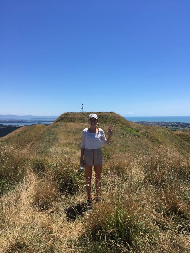 Josie standing on a 'Pa' site (hillfort) in New Zealand