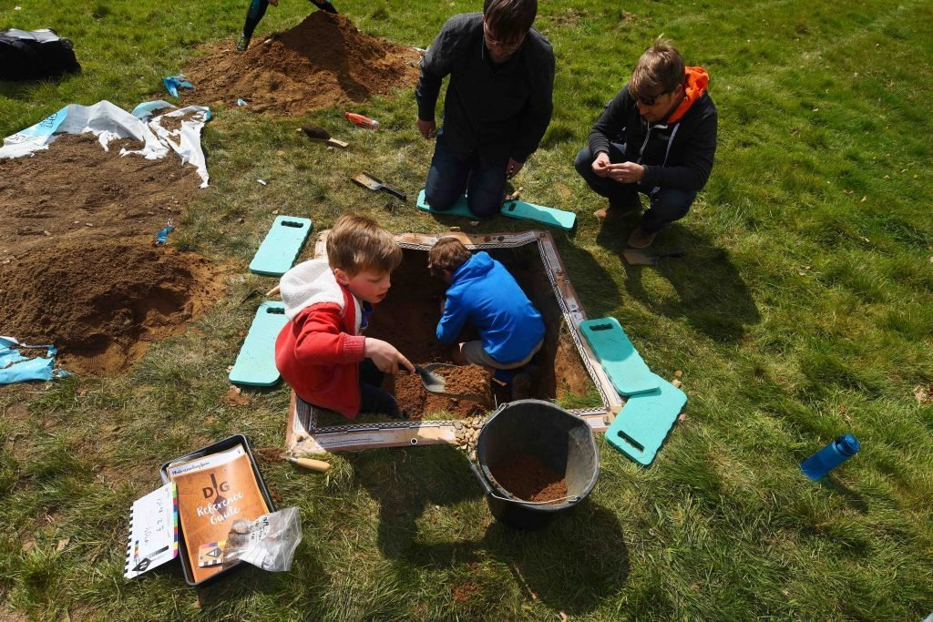A family taking part in Dig Burley at Burley Manor Hotel