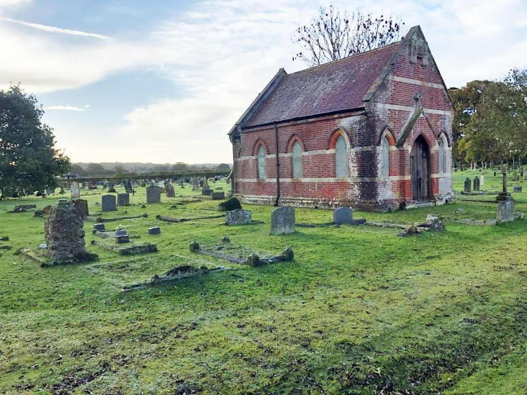 A chapel surrounded by gravestones