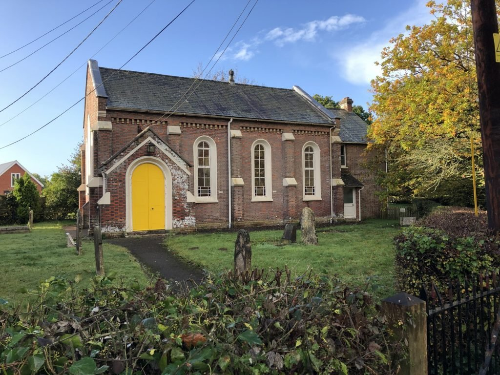 A church with a bright yellow door